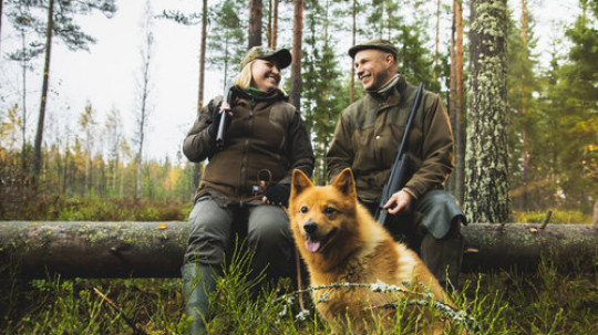 Couple with a hunting dog